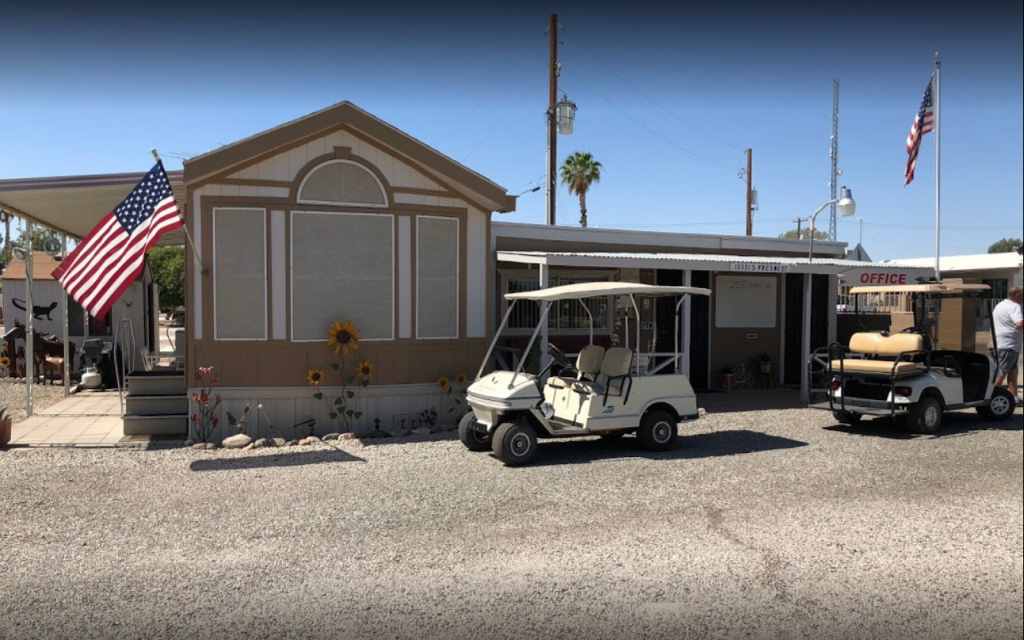 RV Park office with two American flags and two golf carts.
